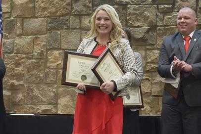 Photo of Emma Blaze holding her GOAL Award.