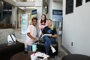 three students in lobby of Forsyth campus