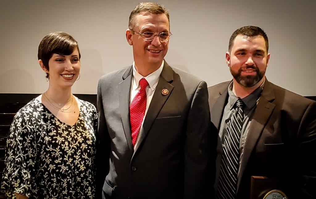 US Representative Doug Collins, presented award, with Susanna and Brandon Carey.